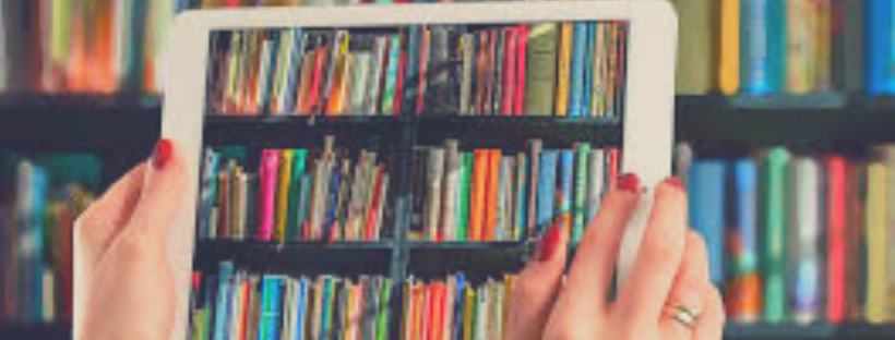 Bookshelf viewed through tablet in woman's hands